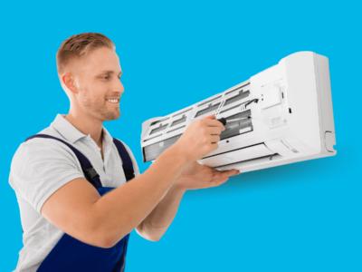 Técnico em refrigeração fazendo a instalação de um ar condicionado